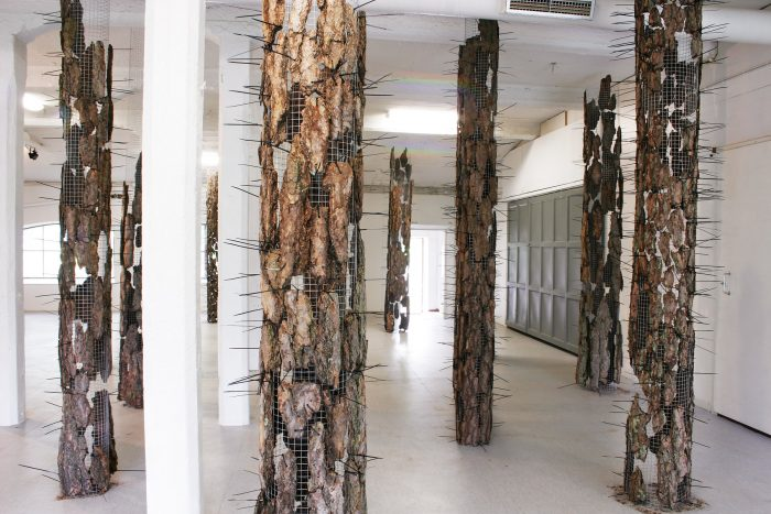 Forest Composition, 2009, installation; chicken wire, bark, cable tie